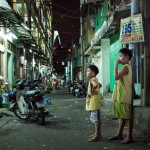 Ho- Chi- Minh city, city district, at night, kids, aim-frame photography
