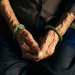 Sign, Cafe Cho-lon, elderly woman's hands, jewellery, aim-frame photography